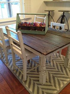 """Tiny human spaces can be anywhere, not just in a """"playroom"""".  It's always nice to have the whole family together.  Love this idea coloring table in a kitchen from Magnolia Homes"""