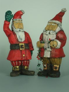 Santa meets Santa. Hand carved from basswood and finished with acrylic and oil