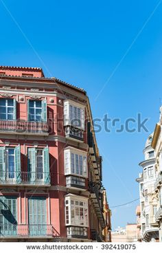 Apartments with small balconies typical architecture. Low angle view down street of apartments with small balconies in the city of Malaga in Spain under clear blue sky Low Stock, Small Balconies, Clear Blue Sky, Places In Europe, Low Angle, Spain Travel, Malaga, Small Apartments, Balcony