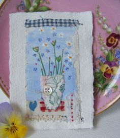 A little bit of painting and embroidery on a small piece of watercolour paper.  Such a warm little 'snap' of artwork and it would be fabulous as a framed piece or even used on a card front.  (It would also look great in a Scrapbook!)