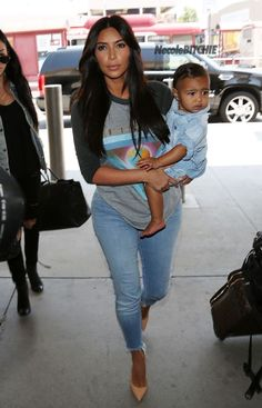 Kim Kardashian and North West arriving at LAX (2)