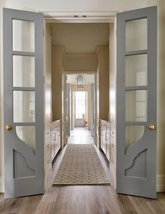 Gray bi-fold doors with glass panels