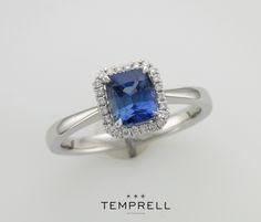 Royal blue sapphire and diamond halo ring. www.temprellbespoke.com
