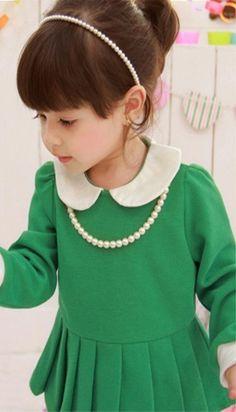 I love this little girl. Green dress ll peter pan collar.