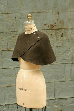 Simple wrap mantle with snaps, buttons, or pinned with a cameo or broach