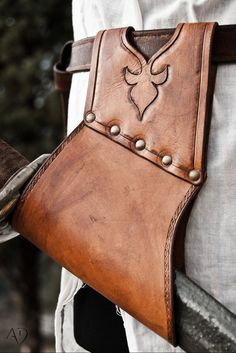 Sword Holster. I'd need something like this to re-use my old sword with a scabbard-free weapons belt that I plan on doing with my new garb.