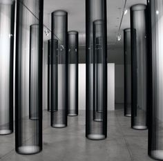 Zilvinas Kempinas (b.1969, Lithuania) - Columns, magnetic tape, painted wood panels, nails set of eight columns (2006) Gallery Yvon Lambert, Paris [more Zilvinas Kempinas | artist found at artwankblog]