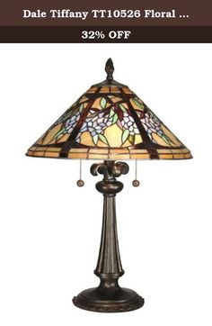 Dale Tiffany TT10526 Floral Branch Tiffany Table Lamp, Antique Bronze. A flourishing floral vine grows around the circumference of the shade in this lovely table lamp. Delicate blue and pink flowers along with vibrant green foliage grow from a dark brown vine, all set against a background of beige and light amber. Each of the 484 pieces of art glass in the shade is lovingly hand rolled and individually set in copper foil for that genuine Tiffany look. The metal base is fashionably reeded…