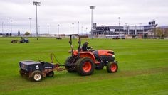 4/30/13 -- Aerating the Intramural Fields with Beaver Stadium in the Background