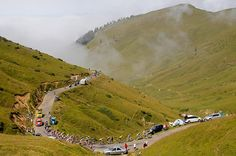 tour stage 17: The riders climb out of the fog on the Port de Bales