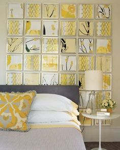 This muted yellow blends with gray to create a calm room. The art wall is cleverly created by using 4 graphic fabrics and framing them all the same. (via MarthaStewart.com