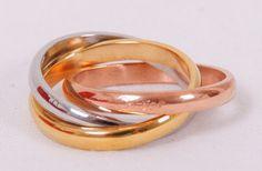 Тройное кольцо Cartier Trinity из трех металлов