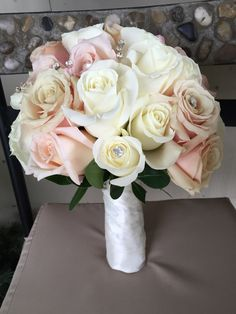 Beautiful bridal bouquet with roses, by Floral Events Chicago.