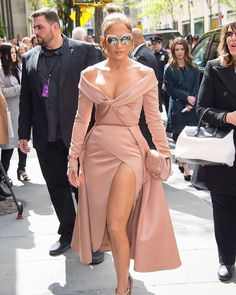 @jlo looked radiant in this blush @eliesaabworld off-the-shoulder dress