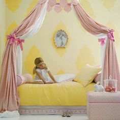 Girls pretty canopy bed. Tie to bed posts