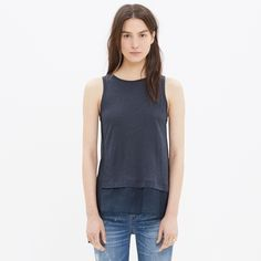 Madewell Mixed Panel Tank Super cute tank top from Madewell! It has sheer side and bottom panels that are cotton/silk blend and soft center panels of model/wool blend. The last picture shows that there are raw edges around the arm openings that are naturally frayed, just the design of the shirt. EUC Madewell Tops Tank Tops