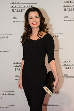 Dutch actress Caroline De Bruijn wore our Pinup Couture - 50s Monica Dress in Black from Laura Byrnes Black Label dress together with our Royal Peach - 50s Ready For The Red Carpet Clutch to the premiere of the National Ballet!