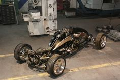 """Quadracycle"" from Brimstone Cycles is a hybrid vehicle that combines the features of a four-wheeled quad, a motorcycle and a drag car to scorch the road with a power ride. Powered by a 455 cubic inch aluminum Dart V8 engine capable of generating 750 horsepower"