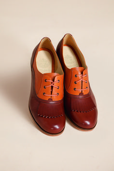 Coveting shoes like this for fall.  I'm predicting a lot of lace up oxfords in every color and heel height.
