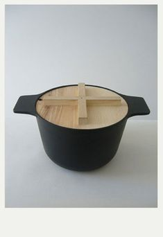 Perfect Dutch Oven - Cast Iron with wood lid that can be used as a trivet - Lukas Machnik