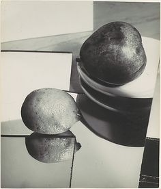 [Still-life with Lemon and Pear] Florence Henri - ca. 1929 - Gelatin silver print. Henri studied painting with Léger and Ozenfant before she took up photography at the Bauhaus. Like the other phenomenological puzzles she constructed with mirrors, this still life demonstrates that in the camera's description reflections are coequal with material realities. In the terms of her picture--if not on the grocer's scale--the doubled lemon weighs precisely as much as the pear.