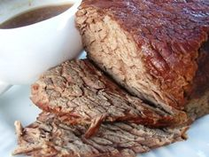 Crock Pot Roast Beef w Gravy 4 lbs boneless sirloin tip roast 1/2 cup all-purpose flour, divided 1 (1 1/4 ounce) envelope onion soup mix 1 (1 1/4 ounce) envelope brown gravy mix 2 cups water (add potatoes / carrots?) Mix all ingredients. Put meat in pot & pour rest on top. cook 6-8 hrs on low.