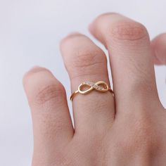 I want an infinity ring so bad. I think i'll buy one after I know my colors on Sunday.