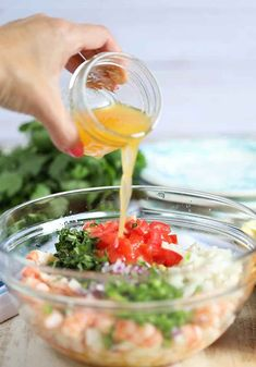 Ingredients for Shrimp Ceviche in a glass bowl with dressing being poured. Quick easy Shrimp Ceviche recipe that is ready in minutes with no cooking required. Shrimp Recipes, Fish Recipes, Gourmet Recipes, Mexican Food Recipes, Cooking Recipes, Healthy Recipes, Cooking Tips, Mexican Desserts, Freezer Recipes
