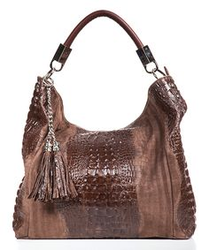 Lucca Baldi Brown Croc-Embossed Tassel Leather Hobo   zulily -  $99.99 $415.00 Product Description:  Juxtaposed textures highlight this Italian-crafted hobo, while the voluminous interior lends ample storage for your essentials.      19'' W x 22'' H x 5.5'' D     15'' strap drop     Leather     Lined     Zip closure     Interior: one zip and one slip pockets and center divider     Removable crossbody strap     Made in Italy