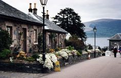 Village of Luss, Scotland.  Attended a wedding on the pier while touring....Groom and groomsmen wore kilts.  What a treat!