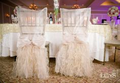 ruffle table and chairs | Above: Ivory organza sleeves with ivory ruffled sashes