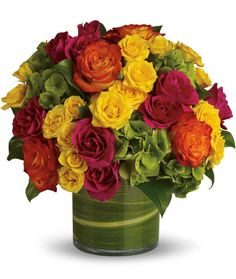 """""""Blossoms in Vogue"""" Flower Bouquet ~ rich jewel-tone roses in pink, yellow, and orange mixed with bright green hydrangea and salal leaves in a clear glass cylinder lined with variegated aspidistra leaves, 12""""h overall ~ these would be beautiful for a summer evening garden party! 