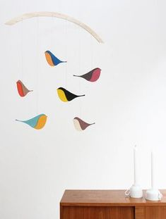 A mobile for any room, any age and any style, simple and beautiful. Funny -- I'm suddenly hitching to get my hands on a thin piece of wood and a paint brush... But that would be silly, given that it's available on Etsy (SaltyandSweet) for dinner and a movie.