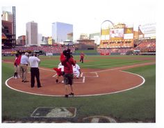 Steve Schmitt, a Madison College alum and Madison Mallards owner, throws out the first pitch for the St. Louis Cardinals