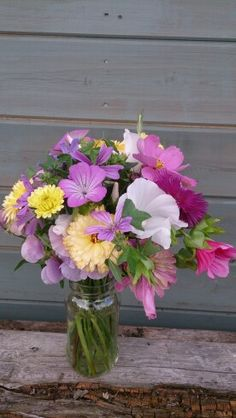 Pink malope, aster and calendula table centres