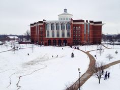 University of Kentucky students sledding in front of W.T. Young library on their snow day.