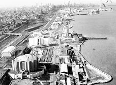 "The fairgrounds of Chicago's second World's Fair, ""A Century of Progress,"" shown here in 1933, stretched along the lakefront from the Adler Planetarium to 37th Street. In the left foreground is the Travel and Transport building, which featured a roof that ""breathed."""