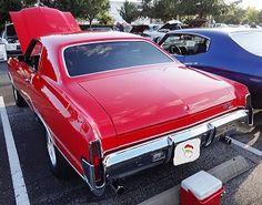 Santa's bright red 1970 Chevrolet Monte Carlo.