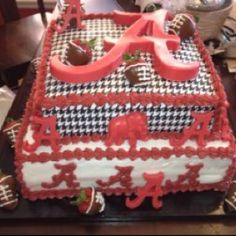 Alabama Groom's Cake  I made this with houndstooth rice paper.  The decorations are all chocolates. The strawberries are dipped in chocolate and decorated to look like footballs.
