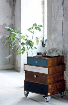 Repurposed drawers as side table on wheels. Would be cute too painted or decoupaged as faux books.