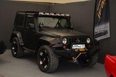 Flat black Jeep Wrangler.