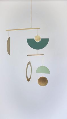 Circle & Line Mobile 23 in Brass and powder coated brass in Botany Green