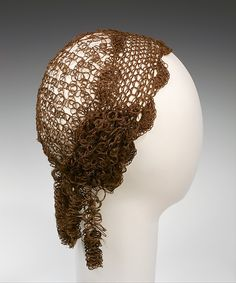 This headpiece is an elaborate example of the Victorian custom of creating jewelry and other accessories from the hair of loved ones. Designed in the style of a mid-nineteeenth-century snood, this cap approximates a hairstyle of the day