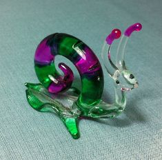 Hey, I found this really awesome Etsy listing at https://www.etsy.com/listing/159405950/hand-blown-glass-funny-snail-animal-cute