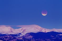 Eclipsed Moon in the Morning. December's lunar eclipse graced early morning skies over the Rocky Mountains in Colorado, USA.