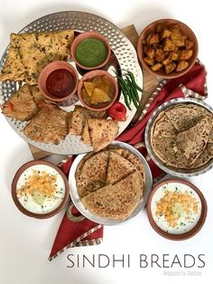Sindhi Breads are a variety of flatbreads that a Sindhi family cooks day to day . Here these have been served together to form a breakfast platter .