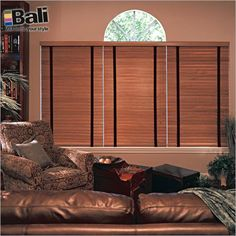 """Bali Northern Heights 2"""" Wood Blinds in Maple with Black Cloth Tapes. North American Basswood slats are strong and light, so they'll be easy to operate for years to come. Find them at Blinds.com."""