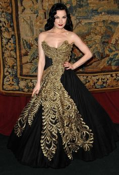 Sensational peacock like black and gold Marchesa gown on Dita Von Teese