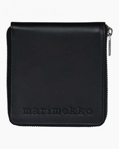 The Enean wallet is made of leather and debossed with the Marimekko logo. The wallet has a zipper closure and it features two billfolds, four card slots and a zipper coin purse on the inside. The inside is lined. Marimekko, Accessories Shop, Shopping Bag, Zip Around Wallet, Coin Purse, Zipper, Unisex, Purses, Leather