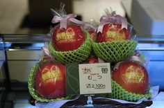 """Short photo article about """"Japan's Perfect Fruit"""". """"Sembikiya's management says the shop helped to establish the trend for giving expensive fruit as gifts in Japan. The business began as a cheap greengrocers, until the wife of the founder's son suggested fruit could be sold as a luxury item""""."""